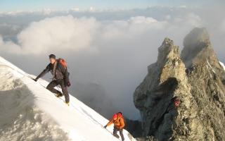 Mountain guide Aurel Salamin and son on the xxx ridge of the xxxxx